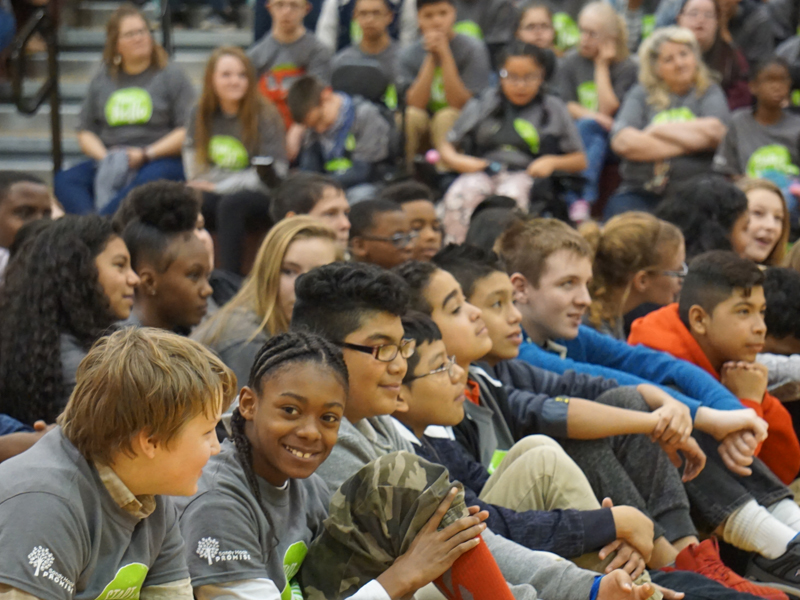 Group of students gather for an assembly. Helping to pass school violence prevention laws, many states have used our model school safety legislation.